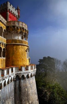 Sintra, Portugal  Beautiful yellow color on the castle wall.  It feels like you are up in the clouds