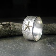Tidepool Starfish - golden brass starfish on hammered sterling with brushed finish.   ...from Lavender Cottage Jewelry