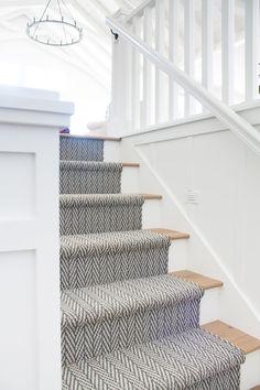 Vintage Home Herringbone stair runner - Oar rack wall decor. Board and batten walls, white oak flooring and chippy vintage oars on oar racks. Oak Stairs, White Stairs, Basement Stairs, House Stairs, Cottage Stairs, Open Basement, Basement Ideas, Cottage Front Doors, Garden Stairs