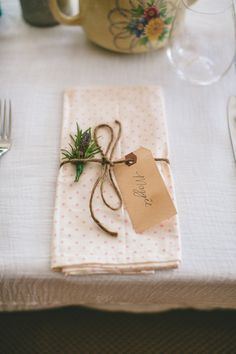 patterned napkins with twine - Read more on One Fab Day: http://onefabday.com/a-colourful-dromquinna-manor-wedding-by-dave-mcclelland/