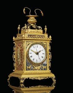 A SMALL GILT-METAL, SILVERED, ENAMEL AND GLASS MOUNTED CHIMING TABLE CLOCK