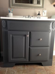 DIY - Paint the bathroom vanity. {paint: Benjamin Moore Charcoal Gray}