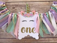 Unicorn ONE high chair banner | Photo prop Perfect for First Birthday parties and photos. Colors can be customized to match your party *Colors shown are: white, pink, lilac, mint green, gold Overall banner length measures approximately 14 long. Unicorn pennant measures