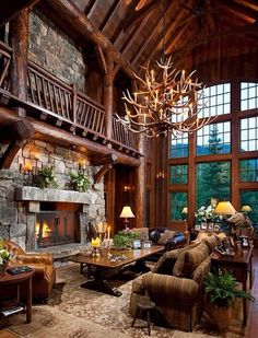 The wood ceiling, fireplace, detail! I love it. My brother, Aslan, would love that chandelier!