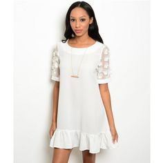 White Ruffle Hem Dress + Floral Appliqué Sleeves White Ruffle Hem Shift Dress + Sheer Floral Sleeves | Floral Shift Dress in White  Scoop neckline Sheer sleeves Floral appliqué on sleeves Ruffle hem Not lined  85% polyester, 12% rayon, 3% spandex Hand wash cold Dresses Mini