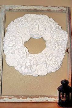 Fabric Floral Wreath. Hang by a ribbon on the wall, add a frame or use a bit of glitter and embellishments for holiday sparkle.
