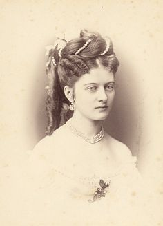 Beautiful lady w/ elaborate hairstyle from the 1870's.