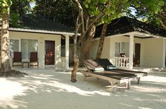 Step through the front door to a tiled veranda facing the beach, furnished with comfy sun loungers – an idyllic place for an afternoon of reading or enjoying the ocean breeze. There is no other Maldives beach hotel accommodation quite like it.