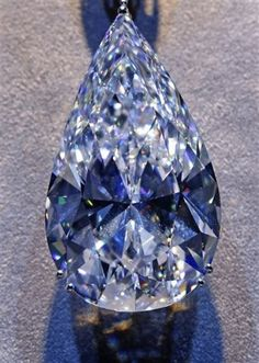 Cut from a 169 carats rough diamond by Safdico's master cutters in New York, 'The Flame' is a historic 100 carat D Colour Internally Flawless pearshape of incredible magnificence and perfection. Diamond Gemstone, Gemstone Jewelry, Rough Diamond, Minerals And Gemstones, Rocks And Minerals, Rare Gems, Rocks And Gems, Diamond Are A Girls Best Friend, Stones And Crystals