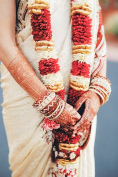henna tattoos and indian sari at wedding. Red, gold and tan colored wedding cloths. www.gideonphoto.com