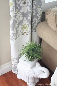 How to Lengthen Drapes That are Too short- master bedroom curtains hung to ceiling with a fun panel