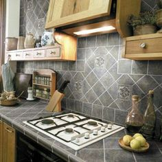 Nice pattern and dark tones. Might look good with white, antiqued cabinets