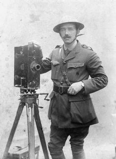 J B McDowell, one of the British official cameraman on the Western Front during the First World War, with a Moy and Bastie cine camera. © IWM