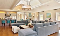 It's  all about scale and size when it comes to decorating this grand, light-filled living room. The focal point of the room is an oversized sectional that provides plenty of seating for large gatherings. Despite it's ample size, the sectional's soft blue hue keeps it from overwhelming the space.