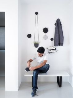 A Young Design Manager Brings Scandinavian Style to His Bachelor Pad - There is a certain elegance in the randomness created by Muuto dots on one of the living room walls - Diy Furniture Tv Stand, Furniture Design, Scandinavian Style, Narrow Hallway Decorating, Flur Design, Interior Architecture, Interior Design, House Entrance, Entryway Decor