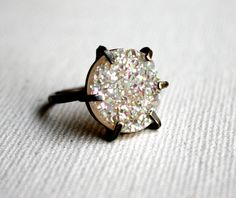 I LOVE THESE! want it so badly. <3 Snow White Drusy In Handmade Oxidized Pronged Setting $108.00