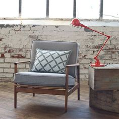 chair and lamp with exposed brick wall