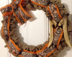 Burlap hunting wreath with realtree camo ribbon and an antler monogram!