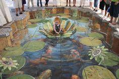 Tromp L'oiel by Julian Beever -- Feeding the fish.