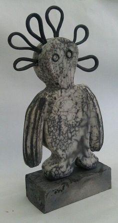 Raku fired Wandjina sculpture