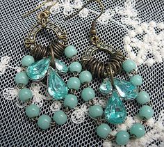 Hey, I found this really awesome Etsy listing at https://www.etsy.com/listing/158131233/assemblage-earrings-vintage-rosary