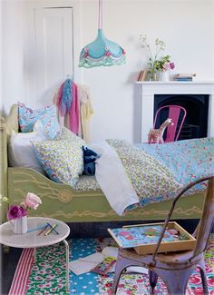 Vintage bed, colorful old chairs, love the light