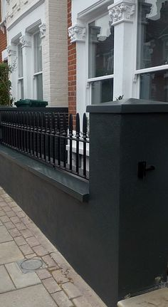 Balham Front garden London company black garden wall A swimming pool is the d… Victorian Front Garden, Victorian Terrace, Olive Garden, Black Garden, Patio, Backyard, Gates And Railings, Small Front Gardens, Dubai Miracle Garden