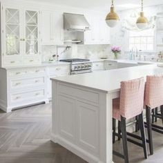 These gorgeous white kitchen ideas range from modern to farmhouse and all in between. Get great ideas on white kitchens with all these home décor tips and designer ideas via A Blissful Nest. http://ablissfulnest.com/ #whitekitchen #kitchenideas #kitchens #farmhouse #farmhousestyle