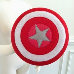 How to make a, quick and easy, super hero shield from a frisbee, some felt and a few other craft supplies.