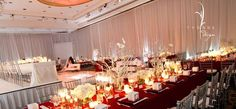 Red & white tables facing a stage