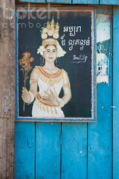 Apsara painting and blue wall | Kep Province, Cambodia