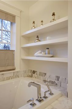 Love the use of these shelves in a bathroom