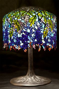 The Wisteria lamp was one of the most iconic designs produced by Tiffany Studios. Its detailed pattern is composition of nearly 2,000 pieces of glass that had to be individually selected and cut. Thanks to that, each Wisteria lamp has its own unique color variations. The Wisteria