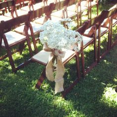 Wedding ceremony chair accents and burlap bows by Butterfly Petals