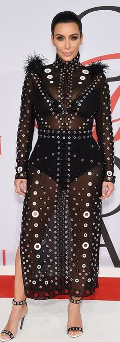 Who made  Kim Kardashian's ring white sandals and black mesh feather gown?