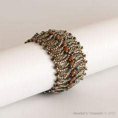 Bracelet in Dark Silver, Tangerine Orange, Turquoise with Mocha Brown Crystals. $92.00, via Etsy.