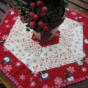 Holiday Hexagon - via @Craftsy  saw a really cute hexagon shaped quilt and i think this could be reworked to the same kind of thing with some enlargements and a change in fabric.