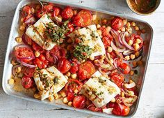 Spice up your seafood supper with this simple traybake recipe. Cod, chickpeas and tomatoes are baked together until tender and dressed in a spicy chermoula mix Tray Bake Recipes, Veggie Recipes, Fish Recipes, Seafood Recipes, Dinner Recipes, Healthy Recipes, Vegetarian Recipes, Healthy Cooking, Healthy Eating