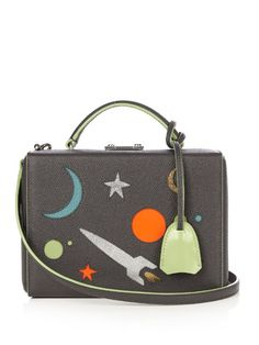 Mark Cross Grace small galaxy-panel leather box bag Mark Cross's asphalt-grey grained-leather Grace box bag is decorated with metallic-silver, green, blue, and orange leather cut-outs – in keeping with the label's sci-fi theme for the new season. This scaled-down version still has plenty of room for your essentials, and can be held using either the top handle or optional shoulder strap. Wear it to put a fun spin on classic ladylike separates.