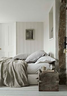 I can't help it. I love raw natural looking spaces. The wood in this one along with those over stuffed pillows looks so welcoming and cozy. No need to make the bed here.
