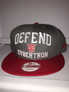 New era transformers defend cybertron snapback with small autobot symbol  front center 0201f7c2a2c