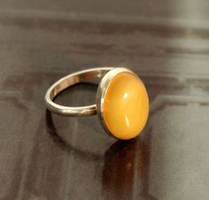 simple oval caramel-yellow amber ring size 8 by IQJewelry on Etsy
