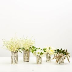 New Year's Eve Winter White Arrangement: Stick to a single flower type in each vase to create a more professional look.