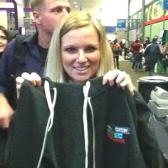 Angie shows off her new hoodie. It's cold here.