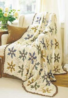 This heirloom afghan features modern flowers in traditional colors. Shown in Patons Decor.