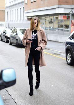 Adidas & camel coat.