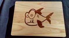 "I made this cutting board with CNC. My friend is a fisherman and he want an unique cutting board. Here is!  Size is: 300mm x 220mm (12""x8,8"") Material is: board is ash wood, model is walnut wood. When I finished, I oiled with sunflower oil."