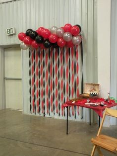 Balloon and streamers photo booth with props www.dandpartycorner.com