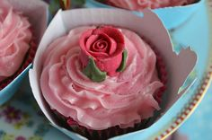 I was so inspired to make these Rosey Posey Cupcakes  after reading the lovely Louise's post yesterday over on Tattooed Lady With A Baby ...