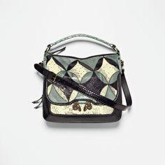 I love this bag..it is so me! I love Derek Lam!